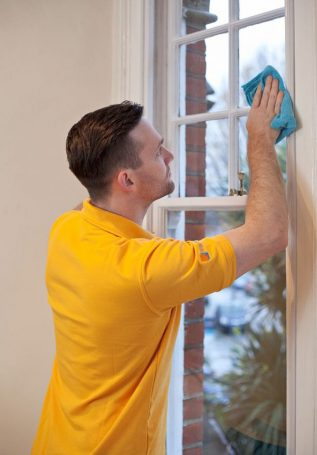 Man installing WindowSkins on sush window