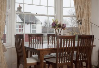 Room with table and chairs, windows with WindowSkins installed