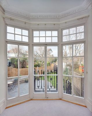 Magnetic Secondary Glazing on French Doors with garden view