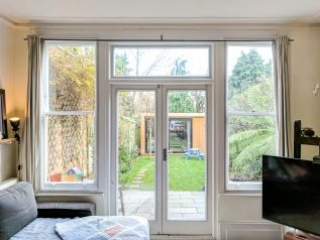 WindowSkins installation on a pair of French Doors with adjoining Sash Windows