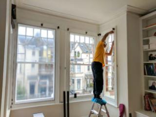 Fitter installing WindowSkins on Sash Window