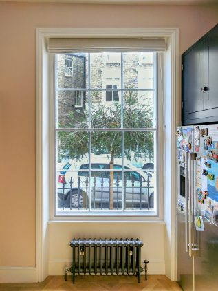 WindowSkins split-panel installation on fine sash kitchen window in Pimlico