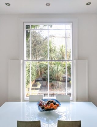Split-Panel Sash WindowSkins Secondary Glazing Installation with half height solid shutters
