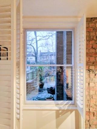 WindowSkins installation on Sash Window with white plantation style shutters
